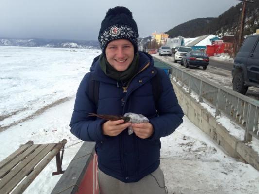 Me, Lake Baikal, and a smoked fish.