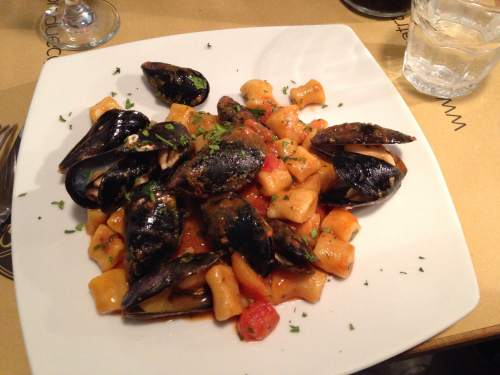 Gnocchi with tomatoes and mussels - divine.