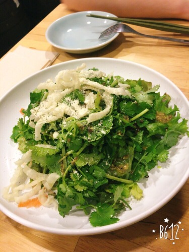 Phakchi salad = a plate of coriander with some crispy bits on top.